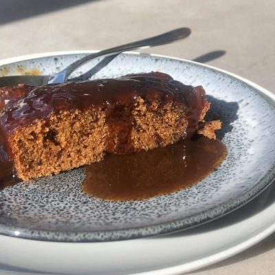 close up of vegan gluten free sticky toffee pudding on a plate