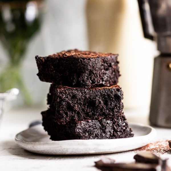 stack of brownie slices on a plate